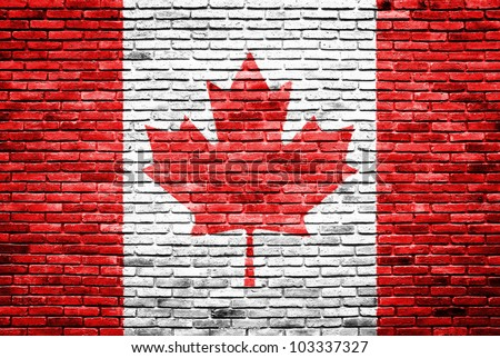 Canada flag painted on old brick wall texture background - stock photo