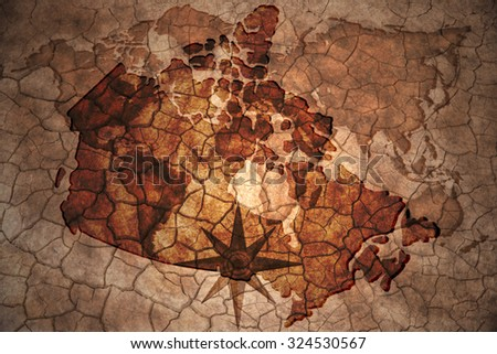 canada map on vintage crack paper background - stock photo