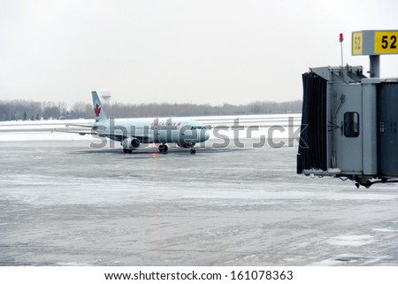 CANADA, MONTREAL-FEBRUARY 3: Landed Air Canada flight about to dock, February 3, 2012 Canada. Pierre Elliott Trudeau International Airport is the third busiest airport in Canada. - stock photo