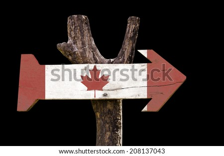 Canada wooden sign isolated on black background - stock photo