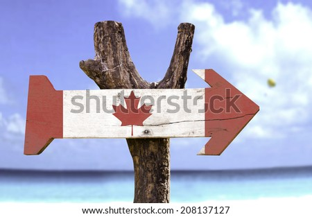 Canada wooden sign with a beach on background  - stock photo