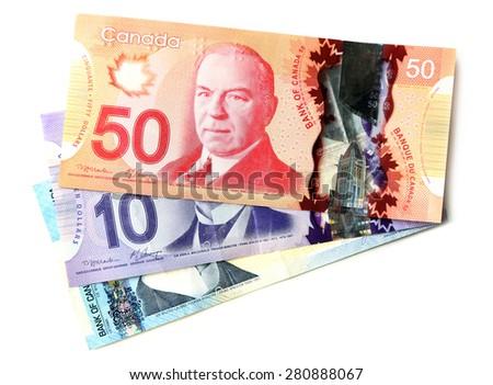 Canadian dollars, isolated on white - stock photo