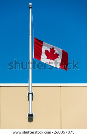 Canadian flag flies at half mast because of the killing of the first Canadian soldier in Iraq during the war against ISIS. - stock photo