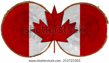Canadian Flag on Section of Tree Trunks. Flag of Canada on two section of tree trunks isolated on white background - stock photo