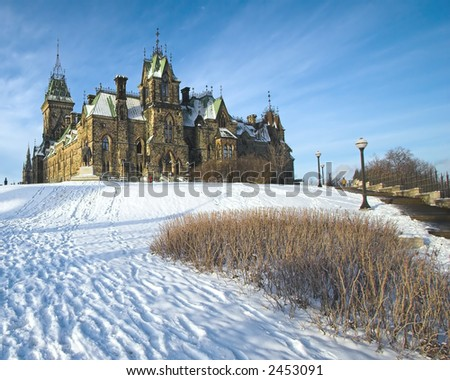 Canadian House of Parliament, on a snowy hill with a blue sky background, Ottawa, Canada - stock photo