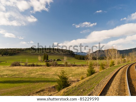 Canadian landscape in spring with rail tracks - stock photo