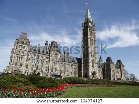 Canadian Parliament Building During The Annual Spring Tulip Festival - stock photo