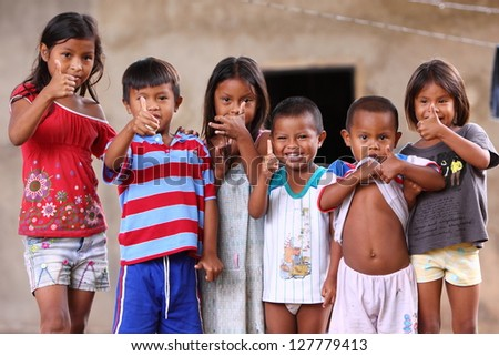 CANAIMA,VENEZUELA-NOV 27:Unidentified children in village showed smiles to the relief team on November 27 2010 in Canaima, Venezuela.People suffers from food shortages due to unstable currency policy. - stock photo