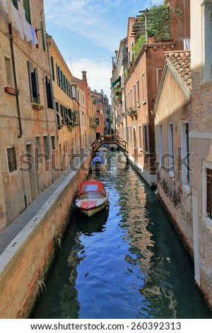 Canal and boat in Venice Italy - stock photo