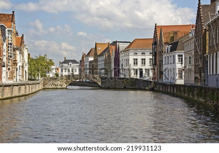 Canal and bridge at the Spiegelrei in central Bruges, Belgium - stock photo