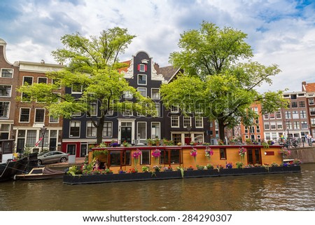 Canal and bridge in Amsterdam, Netherlands in a summer day - stock photo