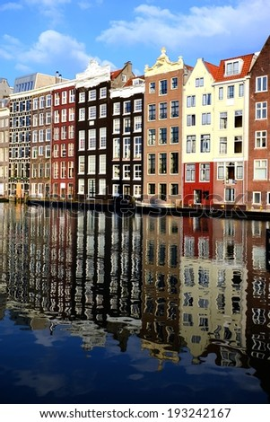 Canal houses of Amsterdam, Netherlands with reflections  - stock photo