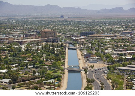 Canal running through downtown Scottsdale, Arizona from above - stock photo