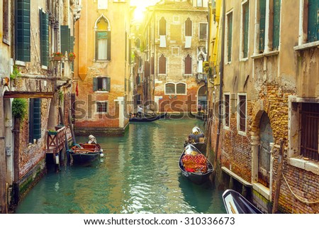 Canal with gondolas in Venice, Italy. Toned image - stock photo