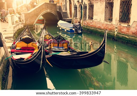 Canal with two gondolas in Venice, Italy - stock photo