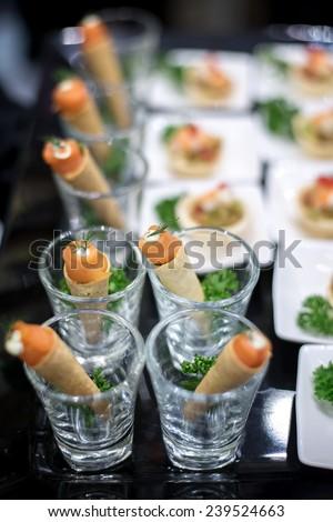 canape selection on slate platter - stock photo