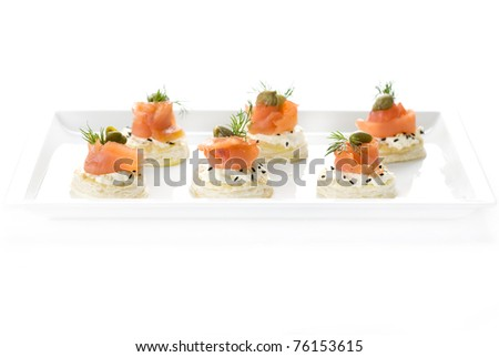canape, snacks, salmon, fish, butter, toast, a restaurant, dill, food, seafood - stock photo