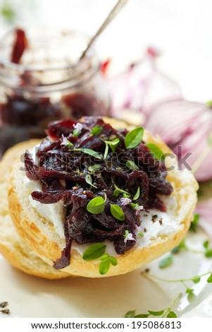 Canape with caramelized onion chutney and creamy goat cheese - stock photo