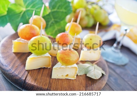 canape with cheese and grape - stock photo
