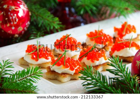 Canape with red caviar for party, selective focus - stock photo