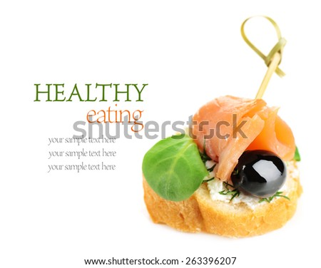 Canape with salmon, black olive and herbs isolated on white - stock photo