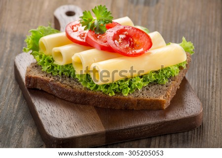 canape with yellow cheese and tomato - stock photo
