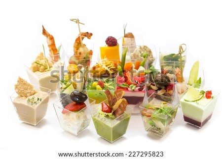 Canapes of cheese vegetables meat and seafood on white background - stock photo