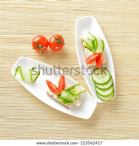 Canapes on plate. Still life. Top view - stock photo