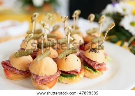 Canapes on restaurant table, spring day light - stock photo