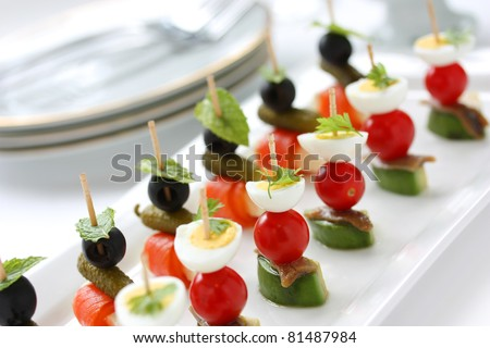 canapes on toothpicks , appetizer, pinchos , spanish food - stock photo