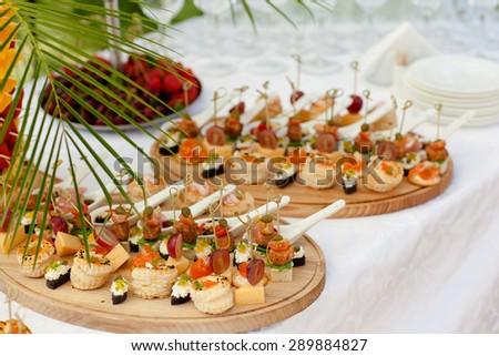 Canapes. Set of mini italian canapes. - stock photo