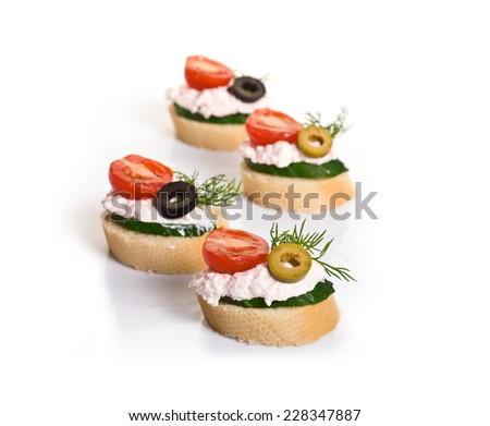 Canapes with Crab Cream, Cherry Tomatoes, Cucumber and Olives isolated on white - stock photo