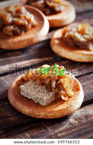 Canapes with liver pate and onion confit, selective focus - stock photo