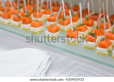 Canapes with salmon - stock photo
