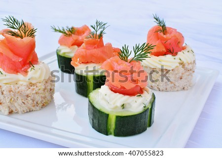 Canapes with smoked salmon, cream cheese and cucumber - stock photo