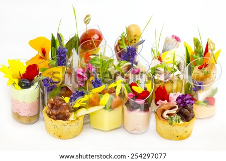 canaps with edible flowers meat cheese and seafood - stock photo