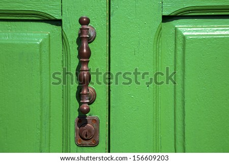 canarias brass brown knocker in a green closed wood  door  lanzarote abstract  spain   - stock photo
