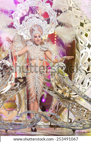 CANARY ISLAND, SPAIN - FEBRUARY 13, 2015: Aranzazu Esteves onstage with costume from designer Fernando Mendez during city of Las Palmas carnival One Thousand and One Nights Queens Gala show. - stock photo