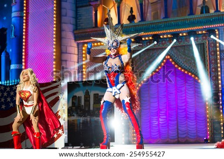 CANARY ISLAND, SPAIN - FEBRUARY 20, 2015: Drag Dafne del Giogio (r) and unidentified assistant with Superman costume performing onstage during city of Las Palmas carnival Drag Queen Gala. - stock photo