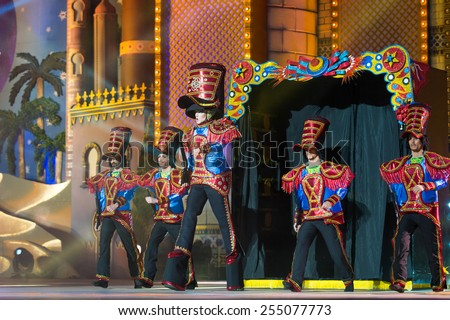 CANARY ISLAND, SPAIN - FEBRUARY 20, 2015: Drag Foguen as Tin soldier costume from designer Blas Francisco Castellano and unidentified assistants onstage during Las Palmas carnival Drag Queen Gala. - stock photo