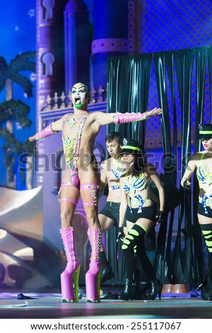 CANARY ISLAND, SPAIN - FEBRUARY 20, 2015: Drag Gio costume from designer Raico Santana and unidentified assistants as policemen performing onstage during city of Las Palmas carnival Drag Queen Gala. - stock photo