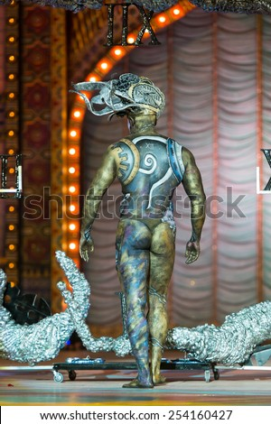 CANARY ISLAND, SPAIN - FEBRUARY 17, 2015: Guzman Gomez Dominguez seen from the back onstage during city of Las Palmas carnival One Thousand and One Nights Body Painting Contest. - stock photo