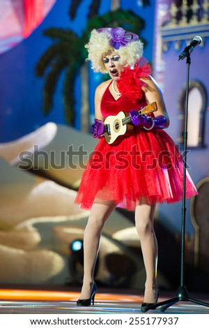 CANARY ISLAND, SPAIN - FEBRUARY 20, 2015: Los Quintana from Spain with red costumes singing onstage during city of Las Palmas carnival One Thousand and One Nights Drag Queen Gala. - stock photo