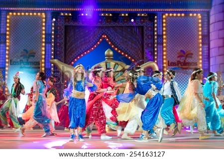 CANARY ISLAND, SPAIN - FEBRUARY 15, 2015: Unidentified children dancing and singing onstage during city of Las Palmas carnival One Thousand and One Nights Junior Queen Gala opening show. - stock photo