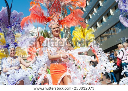 CANARY ISLAND, SPAIN - FEBRUARY 17, 2015: Unidentified woman from Comparsa Nuevo Estilo dancing samba in the streets during city of Las Palmas carnival in the sun. - stock photo