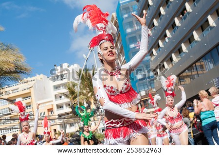 CANARY ISLAND, SPAIN - FEBRUARY 17, 2015: Unidentified women from Comparsa Chiramay dancing samba in the streets during city of Las Palmas carnival in the sun. - stock photo