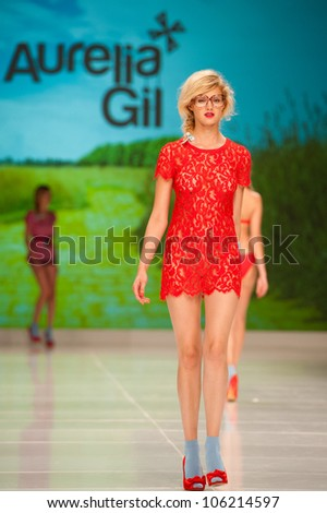 CANARY ISLANDS -JUNE 22: An unidentified model walks the runway in the Aurelia Gil collection during Gran Canaria Moda Calida swimwear fashion show on June 22, 2012 in Canary Islands, Spain - stock photo