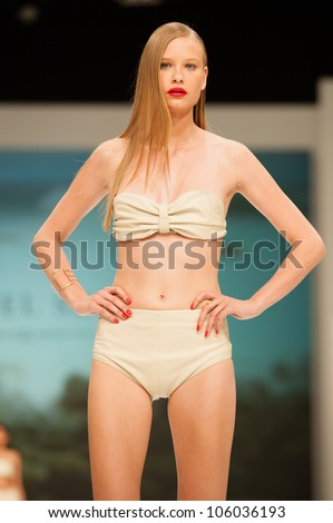 CANARY ISLANDS -JUNE 23: An unidentified model walks the runway in the Gabriel Segui collection during Gran Canaria Moda Calida swimwear fashion show on June 23, 2012 in Canary Islands, Spain - stock photo