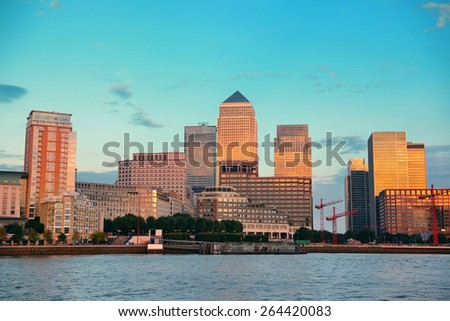 Canary Wharf business district in London at sunset.  - stock photo