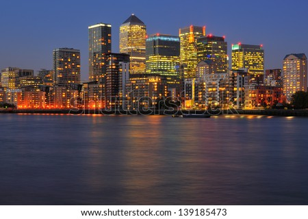 Canary Wharf business district, London UK at twilight  - stock photo